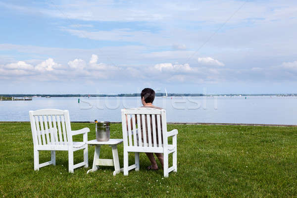 Retired lady by bay with champagne Stock photo © backyardproductions