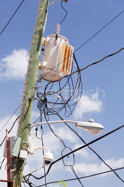 Jumble of wires on power pole Stock photo © backyardproductions