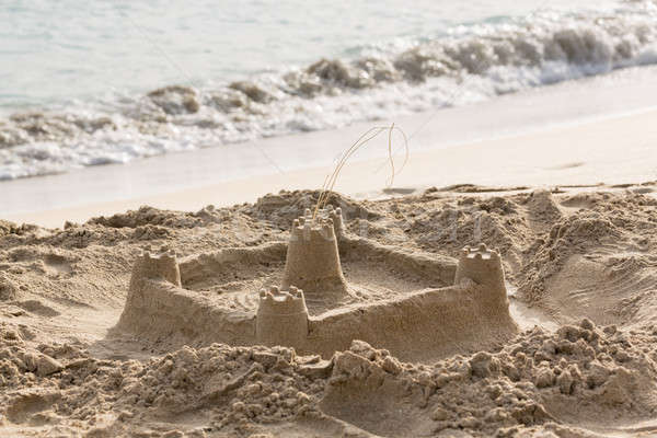 Childs sand castle on beach by ocean Stock photo © backyardproductions