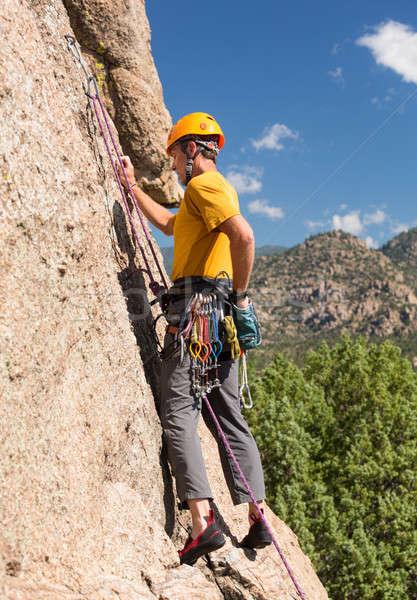 Senior man starting rock climb in Colorado Stock photo © backyardproductions