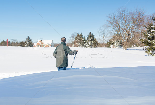 Senior adult man trying to dig out drive in snow Stock photo © backyardproductions