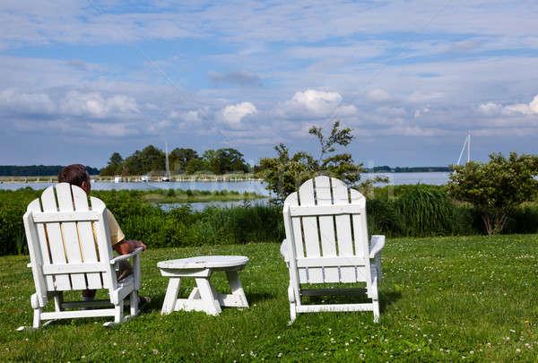 Single senior man in white chairs overlooking bay Stock photo © backyardproductions
