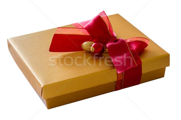 Gold color box with red ribbon in bow Stock photo © backyardproductions
