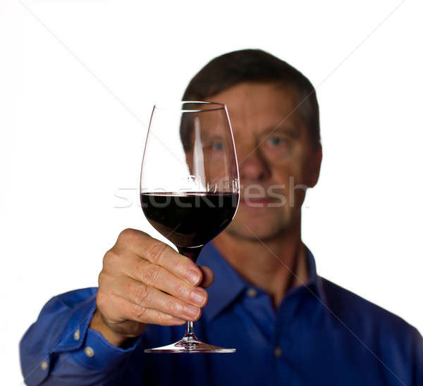 Senior man with glass of red wine Stock photo © backyardproductions