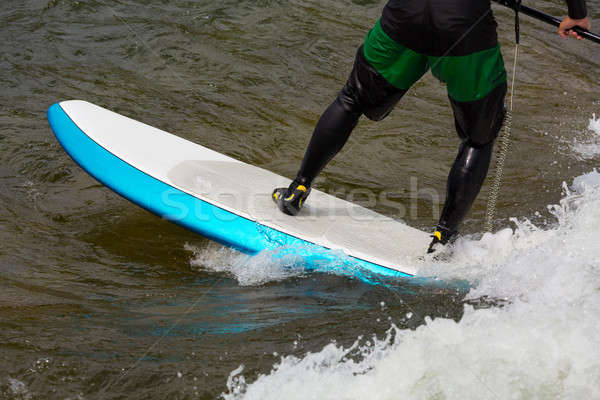 Expert stand up paddleboarder in white water Stock photo © backyardproductions