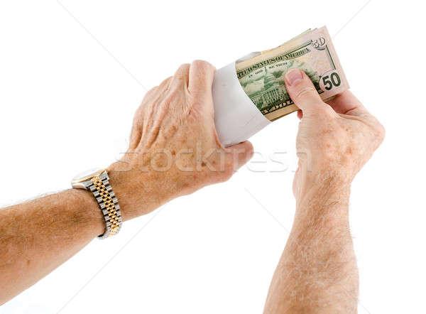 Caucasian ethnicity hands putting fifty dollar bills in envelope Stock photo © backyardproductions