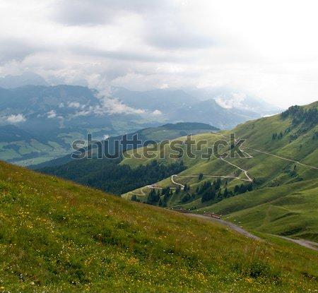 Vadi İsviçre yol yukarı çimenli bulutlu Stok fotoğraf © backyardproductions