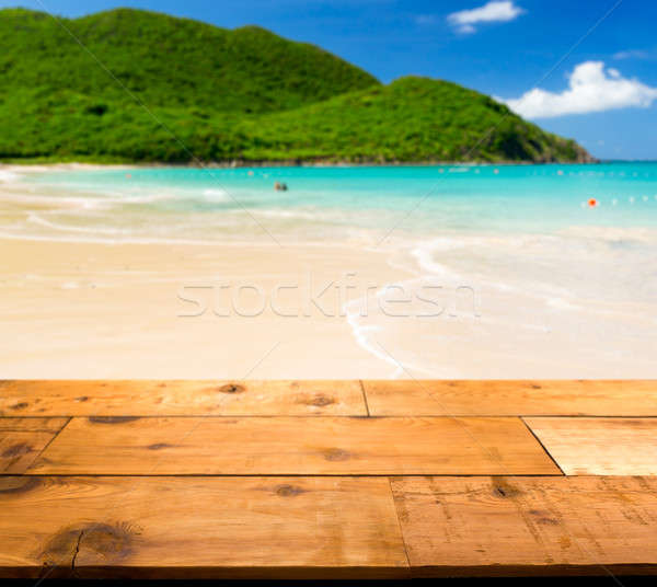 Warm sandy beach in caribbean by wooden decking Stock photo © backyardproductions