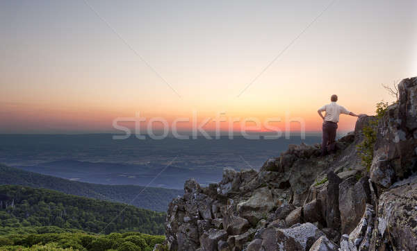 Senior man watches sunrise over blue ridge Stock photo © backyardproductions