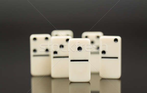 White dominoes showing leader or winner Stock photo © backyardproductions