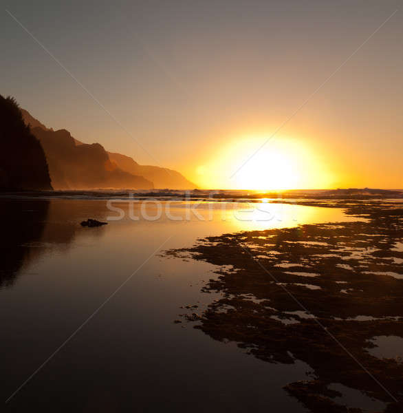 Misty sunset on Na Pali coastline Stock photo © backyardproductions