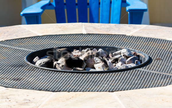 Modern firepit with white hot coals Stock photo © backyardproductions
