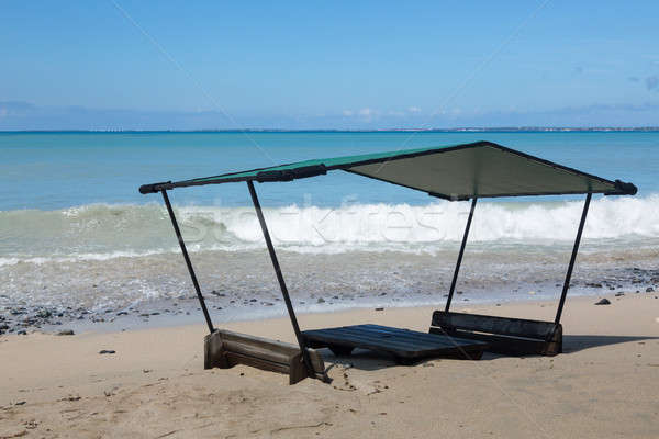 Seats and table on beach covered in sand Stock photo © backyardproductions