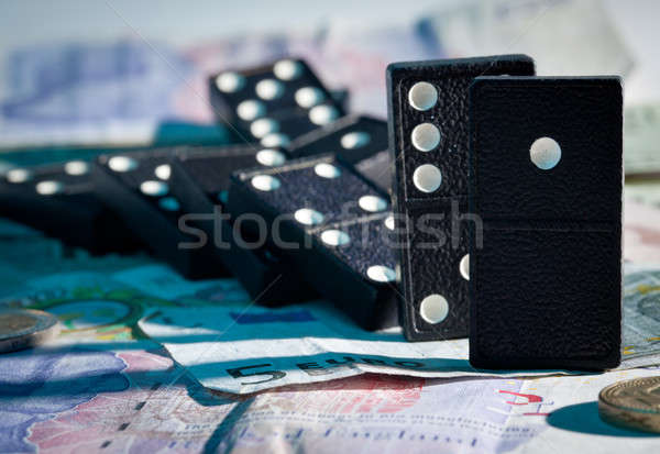 Fallen dominoes on bank notes Stock photo © backyardproductions