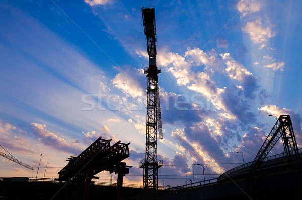 építkezés épület város munka naplemente fém Stock fotó © badmanproduction