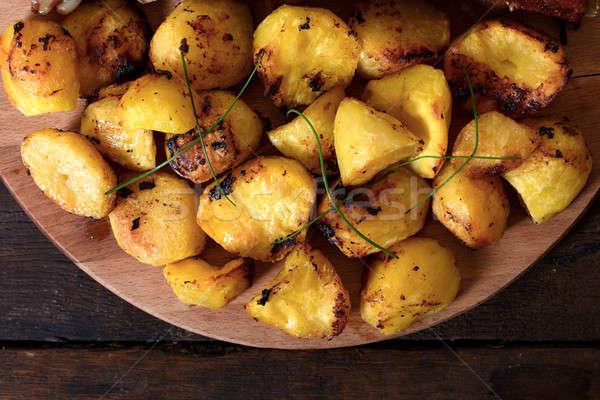 Fresh baked potatoes Stock photo © badmanproduction