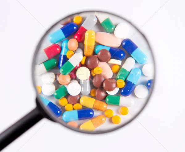 The pills under scrutiny  Stock photo © badmanproduction