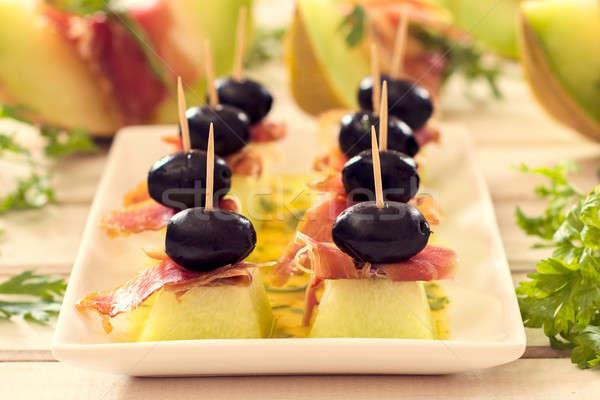 Creativa aperitivo rebanadas verde negro enfoque Foto stock © badmanproduction