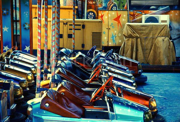 Voiture électrique voitures carnaval voiture amusement roue Photo stock © badmanproduction