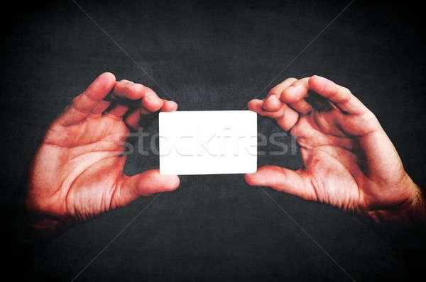 Appelant carte mains ion noir Photo stock © badmanproduction