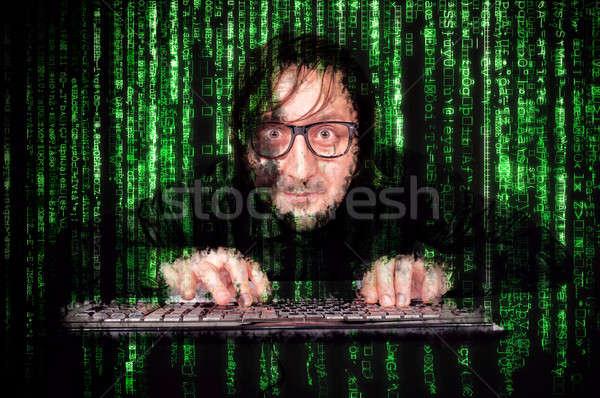 Сток-фото: человека · хакер · действий · клавиатура · матрица · компьютер