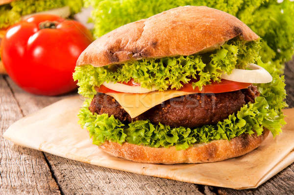 Cheeseburger lecker Gemüse Rindfleisch Fleisch Essen Stock foto © badmanproduction