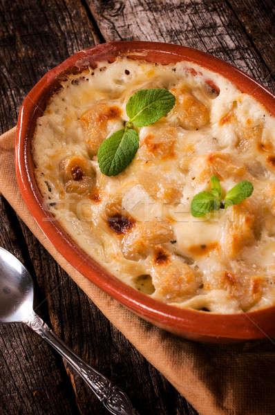 Gnocchi and cheese Stock photo © badmanproduction