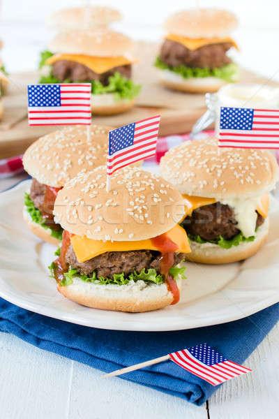 Mini beef burgers Stock photo © badmanproduction