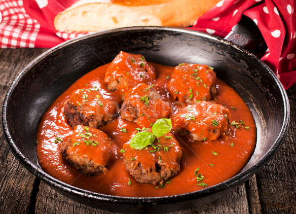 Old pan and meat balls Stock photo © badmanproduction