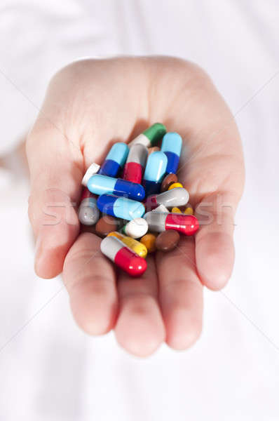 Pills in hands Stock photo © badmanproduction