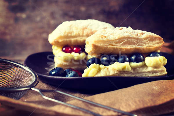 Pudding and berry Stock photo © badmanproduction