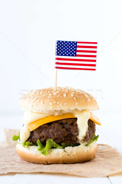 Single beef burger Stock photo © badmanproduction