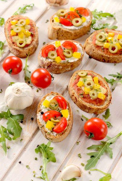Italian bruschettas with vegetables Stock photo © badmanproduction