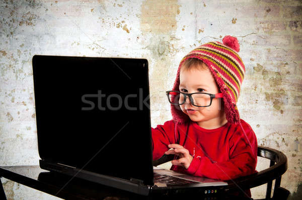 Baby and computer Stock photo © badmanproduction