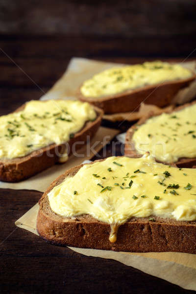 Melted cheese and bread Stock photo © badmanproduction