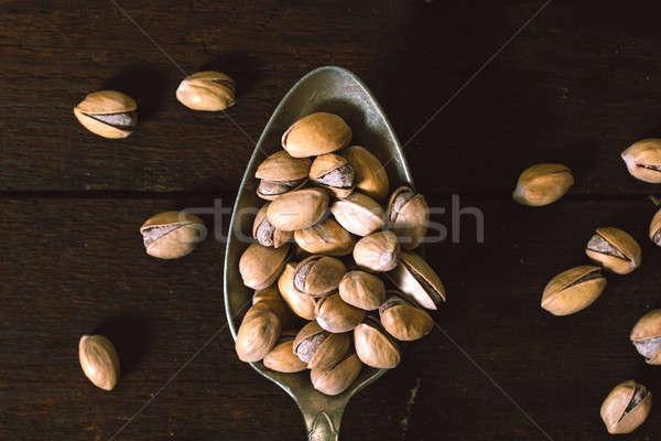 Pisachios in low key Stock photo © badmanproduction