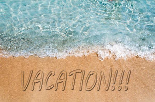 Vakantie woord teken strandzand strand textuur Stockfoto © badmanproduction
