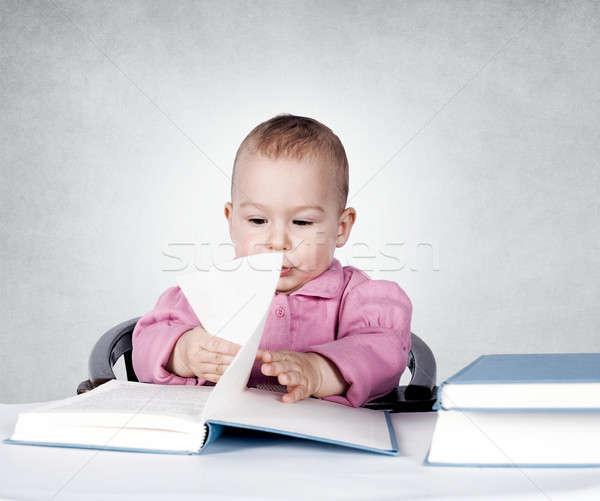 Baby and books Stock photo © badmanproduction