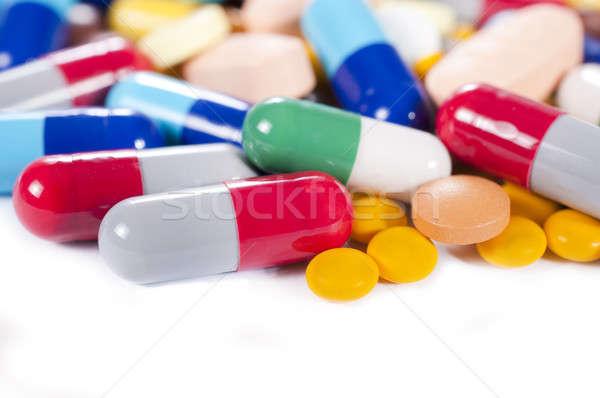 Splashed capsulas Stock photo © badmanproduction