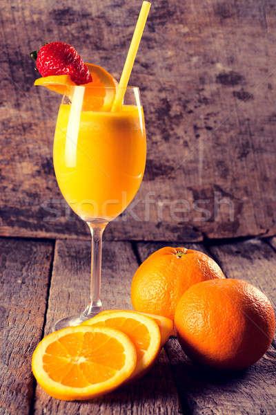 Sinaasappelsap vers focus hout vruchten keuken Stockfoto © badmanproduction