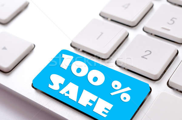 Güvenli satın almak 100 imzalamak klavye iş Stok fotoğraf © badmanproduction