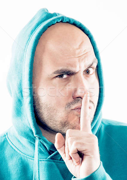 Man showing the sign of silence Stock photo © badmanproduction