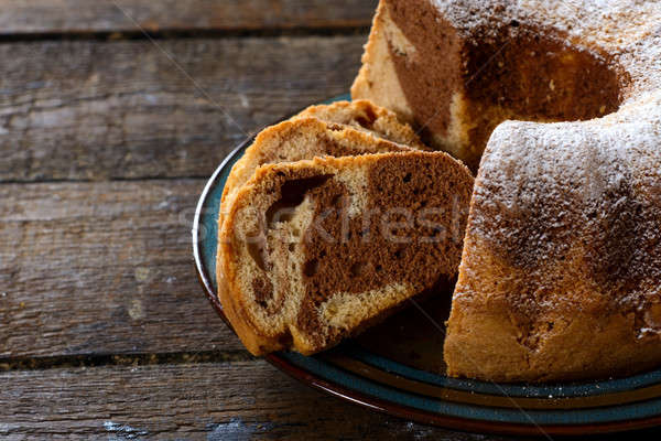 Marble cake in plate Stock photo © badmanproduction