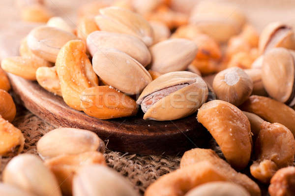 Pistachio and cashew nuts Stock photo © badmanproduction