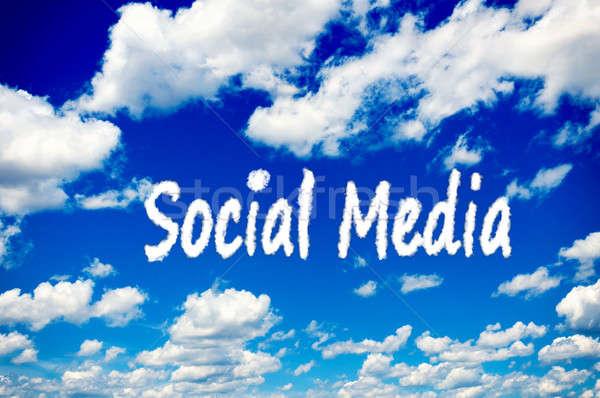 Social media wolken witte blauwe hemel internet wereldbol Stockfoto © badmanproduction