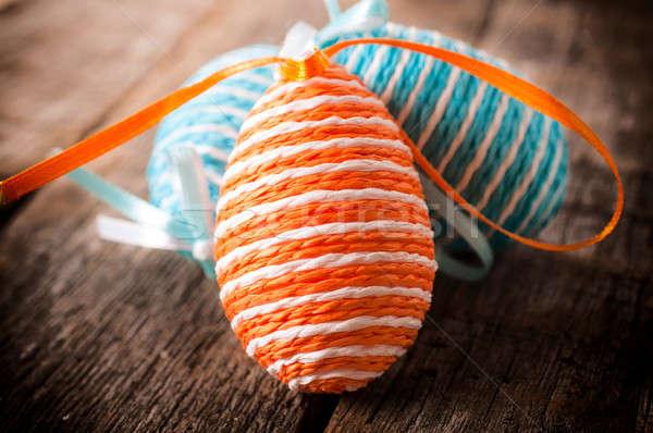 пасхальных яиц избирательный подход оранжевый пасхальное яйцо деревянный стол Сток-фото © badmanproduction