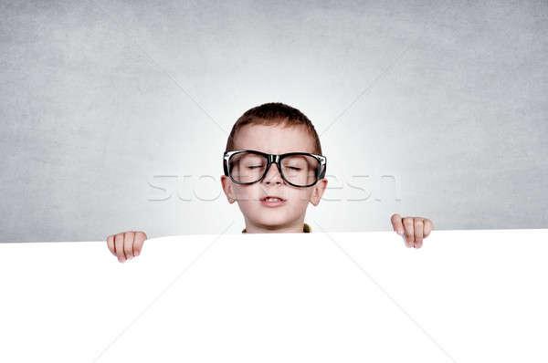 сонный мальчика чистый лист бумаги стороны изолированный Сток-фото © badmanproduction