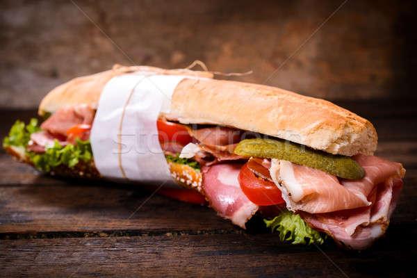 Uzun sandviç prosciutto arka plan domates Stok fotoğraf © badmanproduction