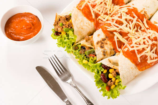 Burritos on white background Stock photo © badmanproduction
