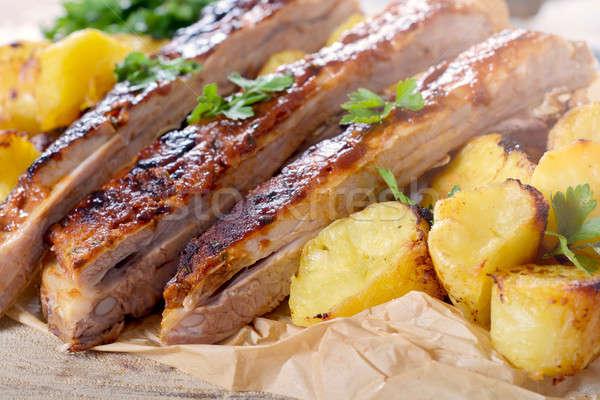 Costelas tempo carne molho de churrasco comida Foto stock © badmanproduction
